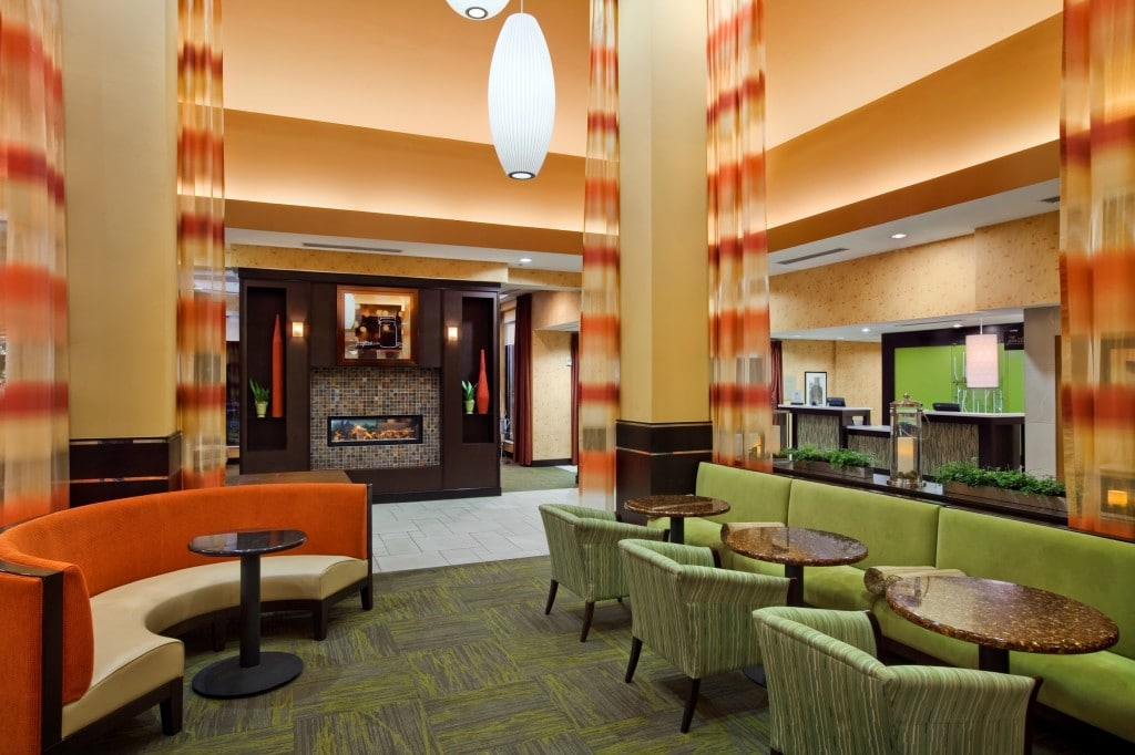 Lobby Seating and Fireplace © Hilton Garden Inn