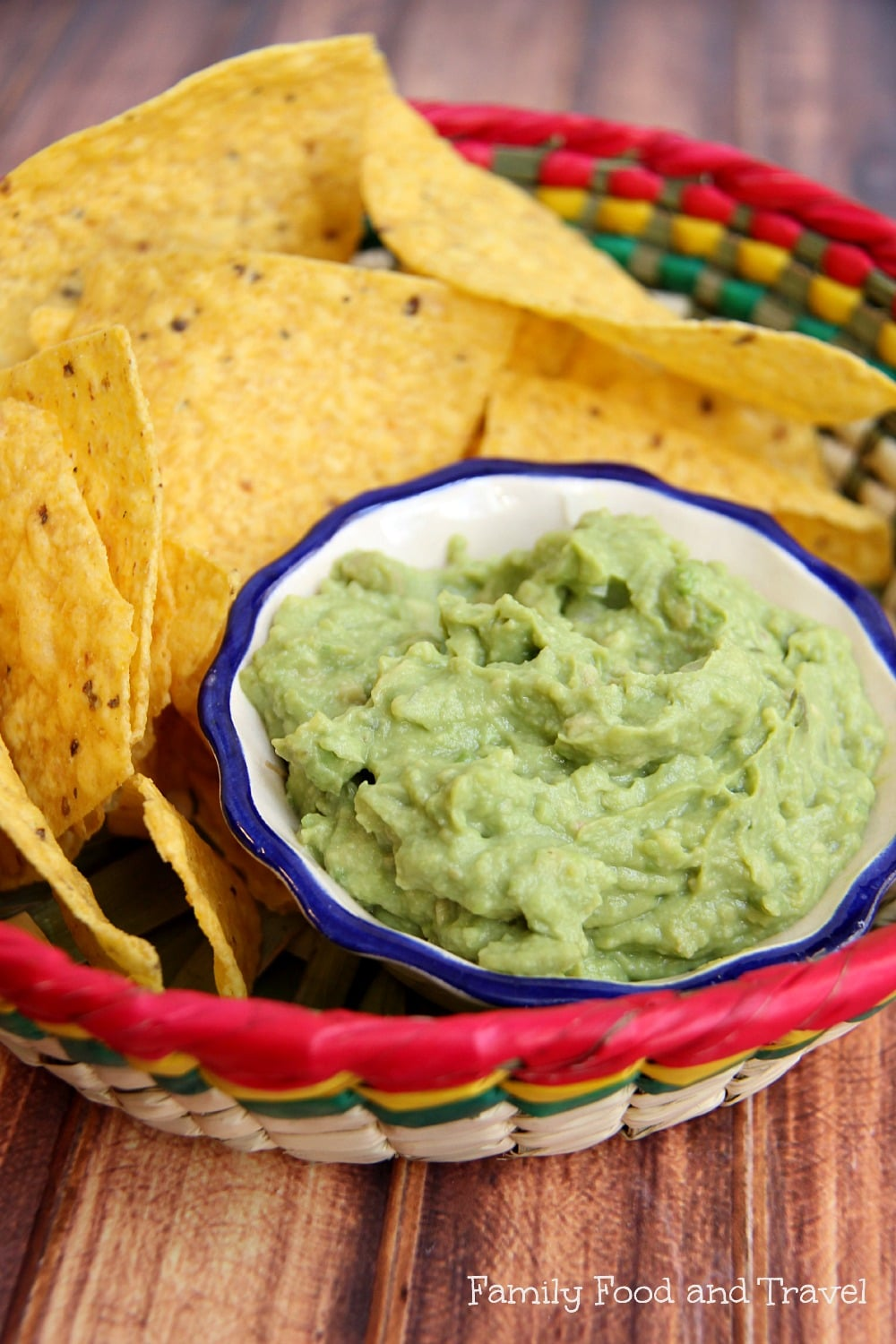 best guacamole in straw bowl with chips
