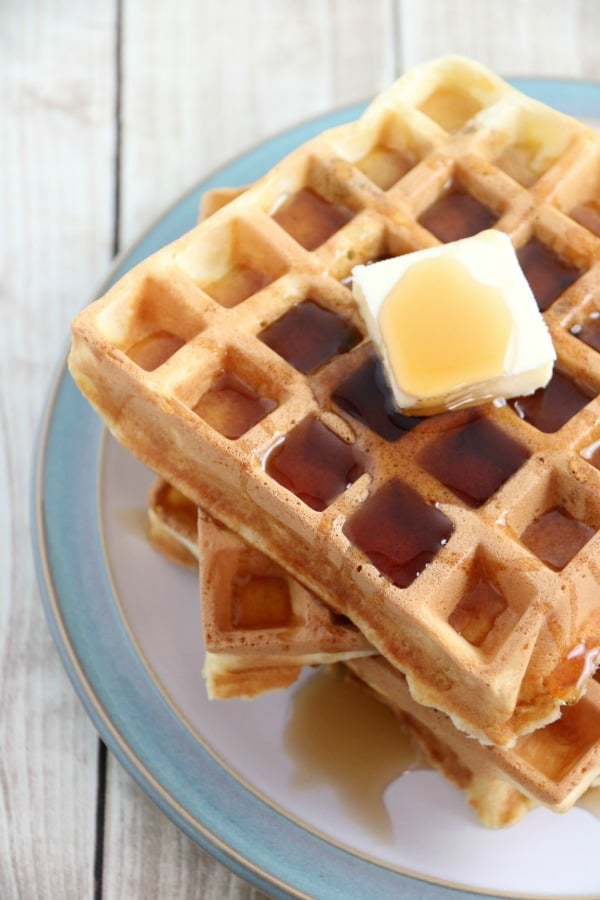 Chocolate Chip Waffles on a plate with butter and syrup